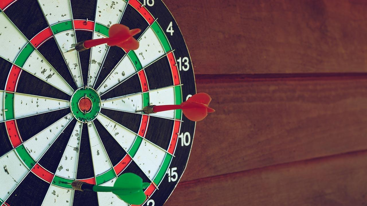 Playing darts - it's that easy - arrows on a dartboard