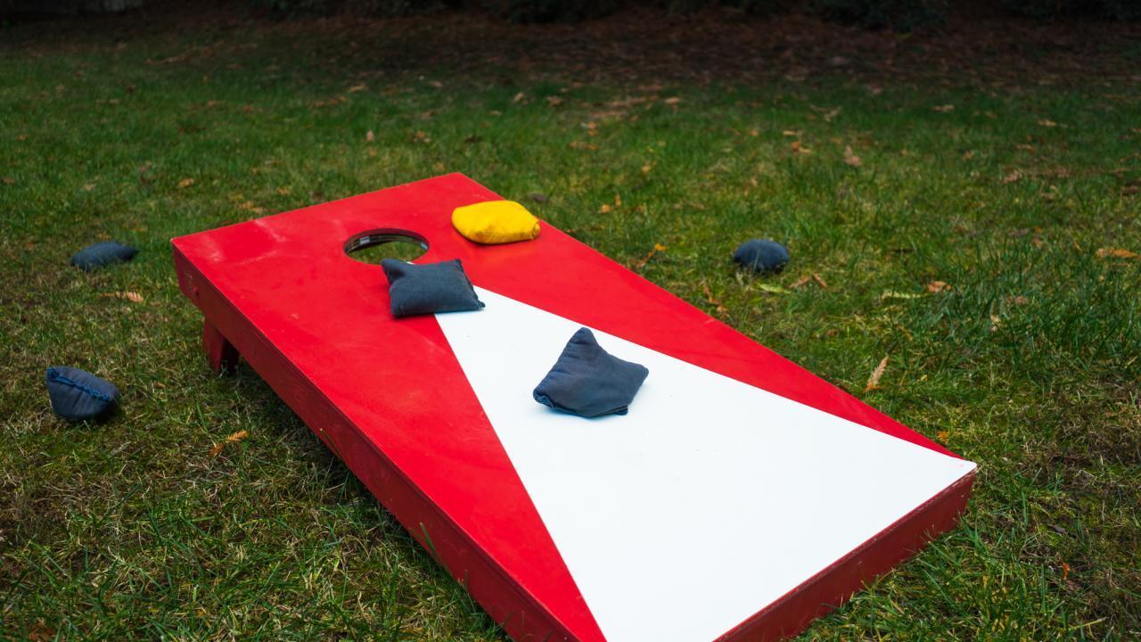 Cornhole - throwing sandbag in your own garden / a cornhole board