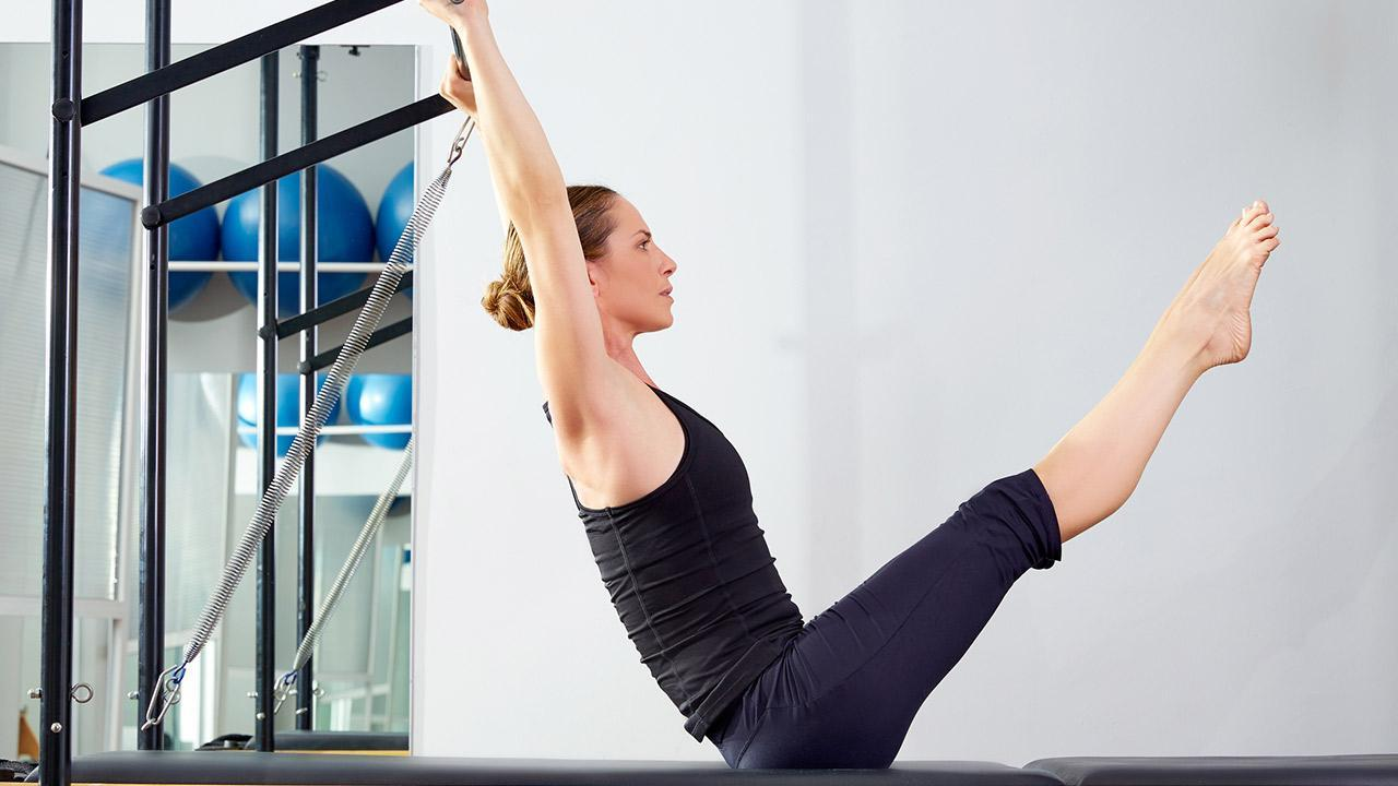 Sports for the home - Pilates - Woman does Pilates