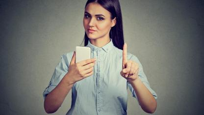 Doing without a mobile phone during Lent - woman refuses telephone