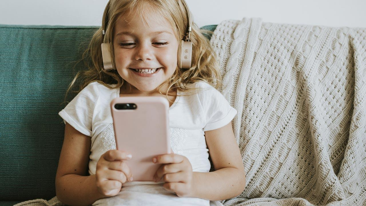 Doing without a mobile phone during Lent - little girl with mobile