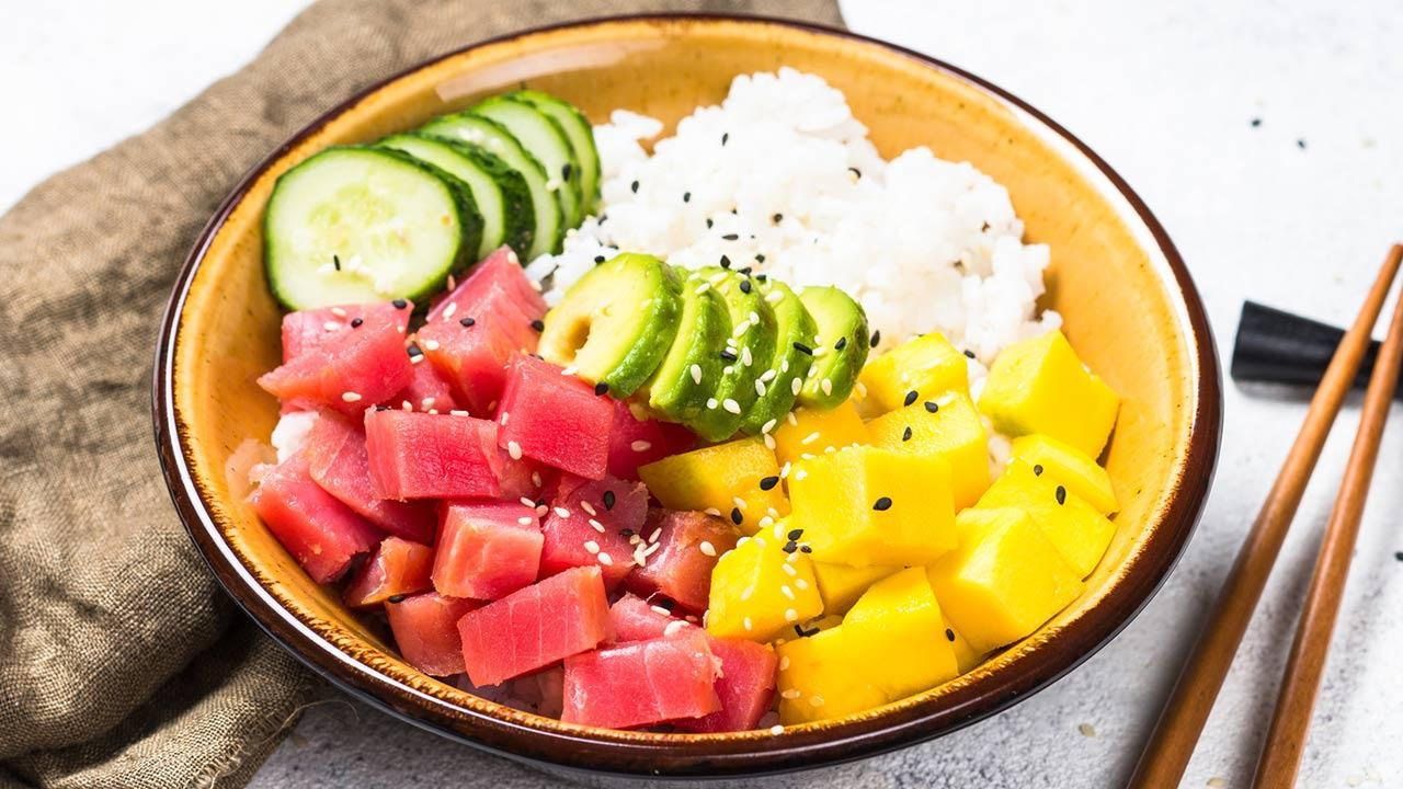 Poke - fish salad from Hawaii / a poke with tuna, avocado and mango