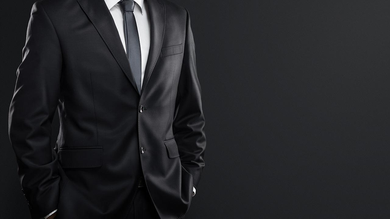 Suit tailor-made or off the rack - a black suit