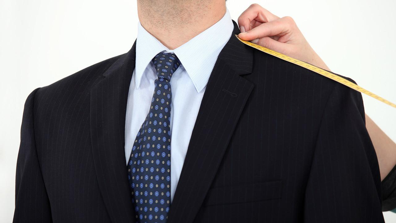 Suit made to measure or off the rack - a suit that was made to measure