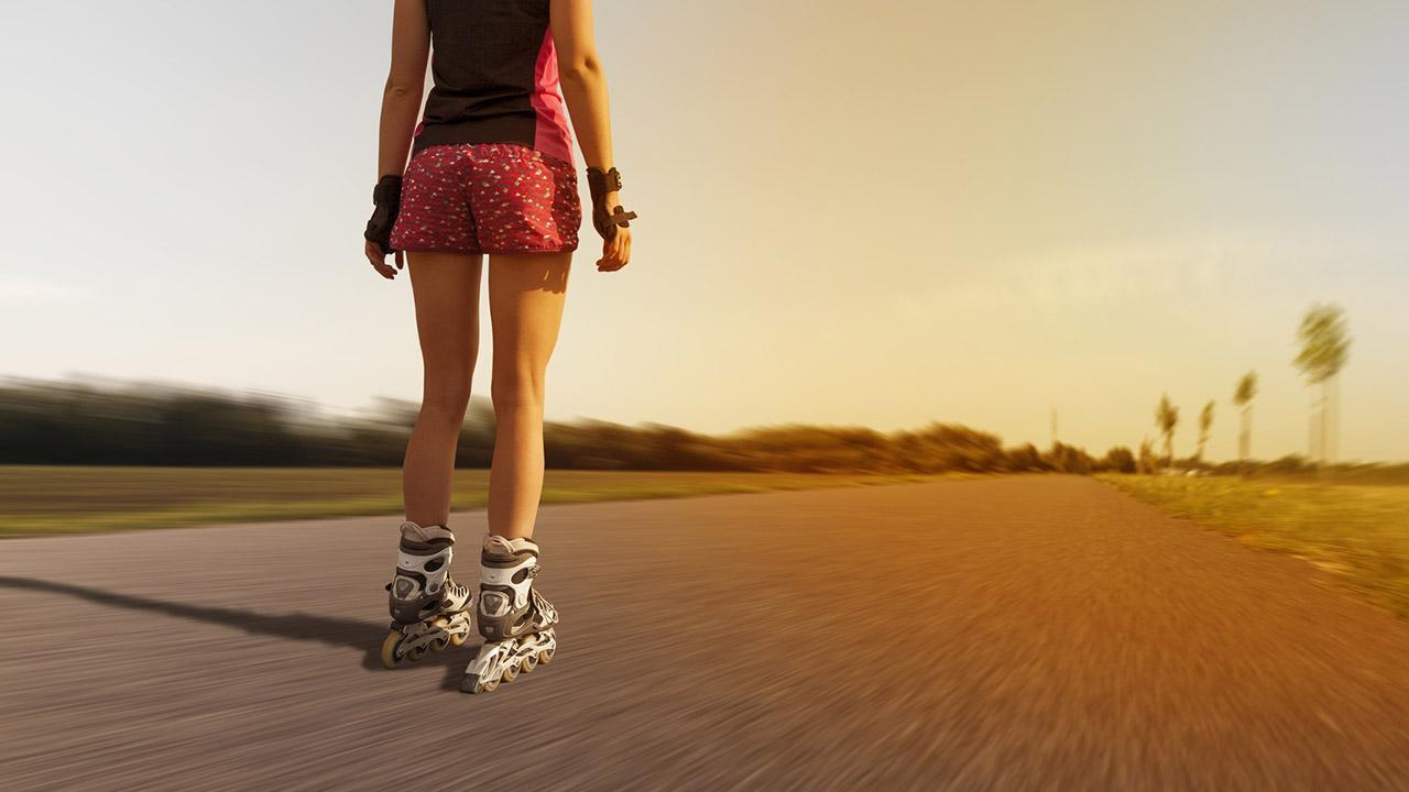 Inline skating for beginners - woman alone on the country road
