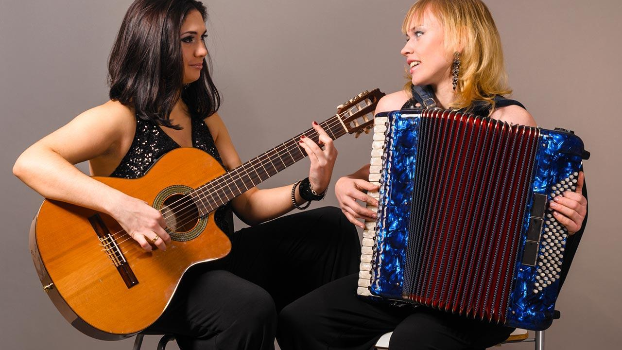 Playing Accordion - How to get started / two women make music with a guitar and an accordion